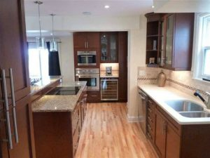 An Open Concept Kitchen Remodel With A Modern Update to the Flooring
