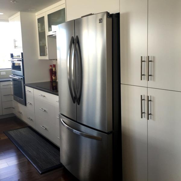 dartmouth condo kitchen remodel sleek cupboards and black quartz counter tops