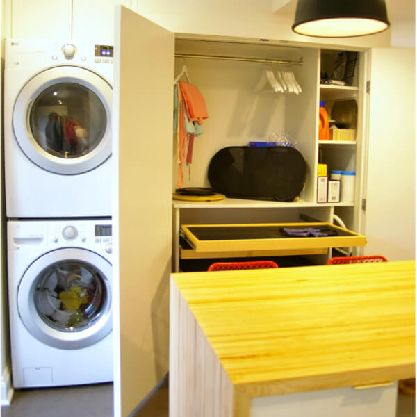 European kitchen addition with stacked laundry and pantry with drying rack