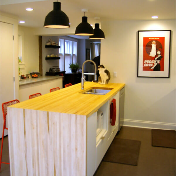 European kitchen addition with stacked laundry butche rblock island