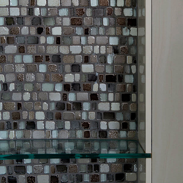 mosaic accent glass shelves in shower