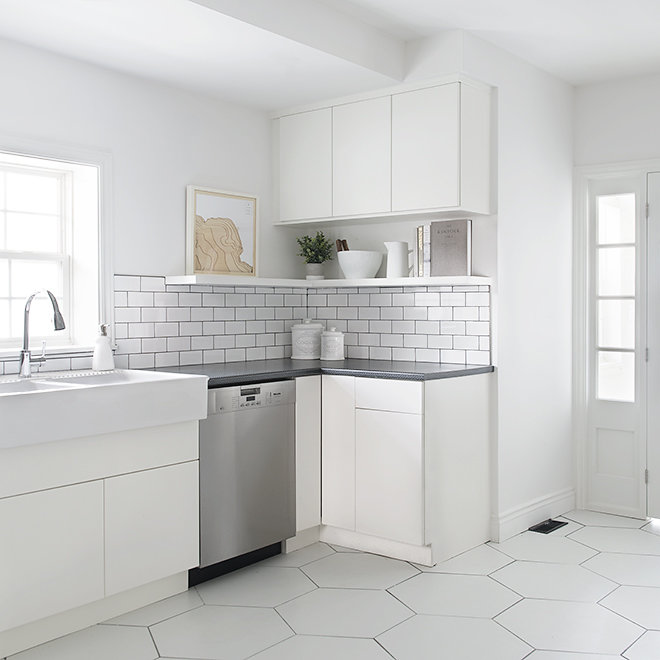 white kitchen open shelves hexagon floor tile