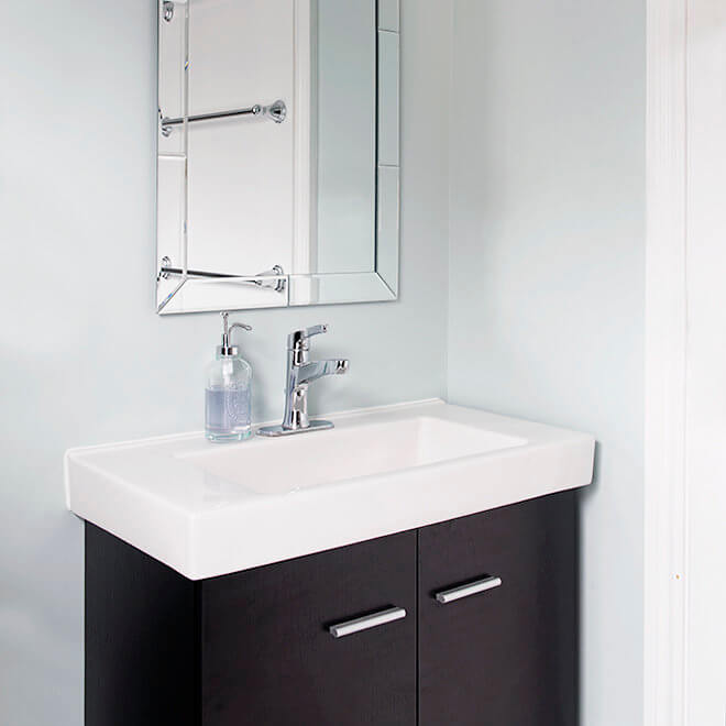 vanity with white vessel sink and beveled mirror