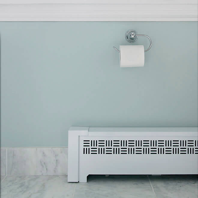 beautiful custom bathroom radiator cover and marble flooring