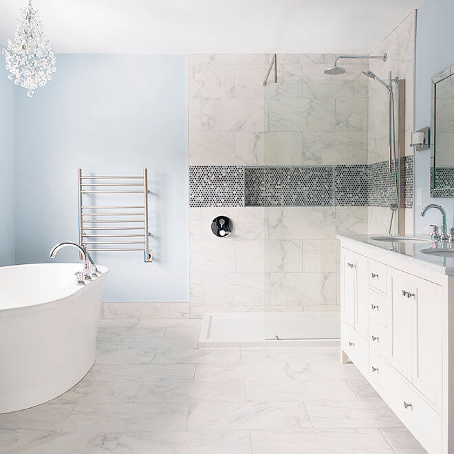 bathroom with marble tile fireplace tv soaker tub pennyround tile accent