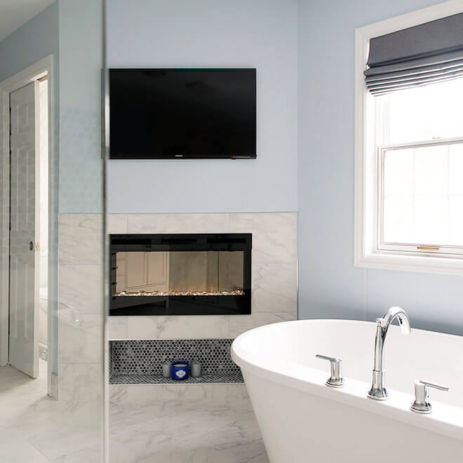 bathroom with fireplace tv soaker tub