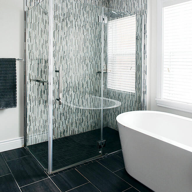 Soaker tub, slate tiles, and custom tiled shower with glass doors Halifax North End Bathroom Remodel