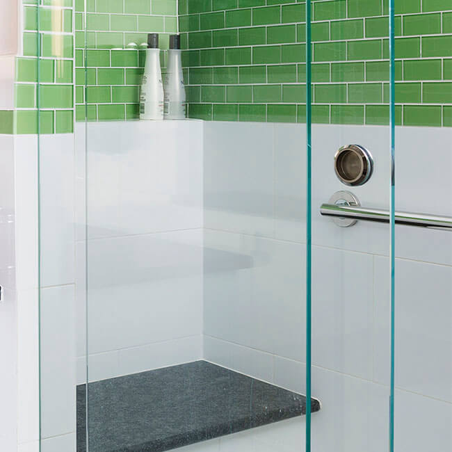 Fun and bright Green tiled bathroom renovation shower built in bench and shelf nook Halifax Case Design Remodeling