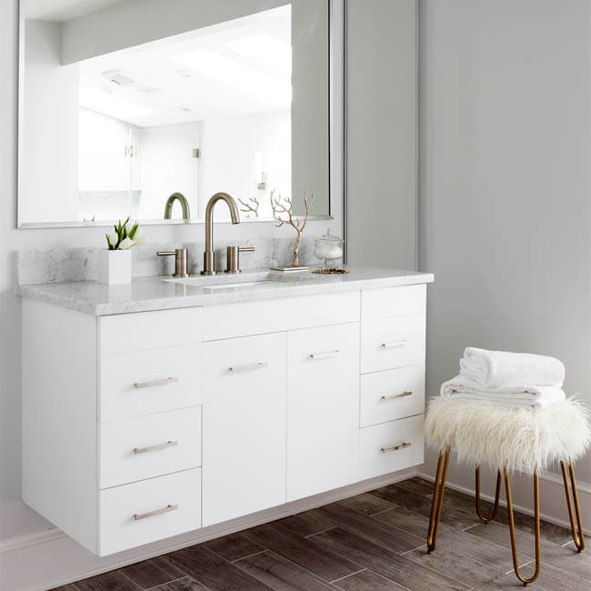 White Luxury Bathroom floating vanity, natural stone wall, natural light from skylights - Halifax Case