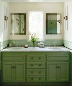 bathroom marble top vanity with windows lighting and plenty of drawers