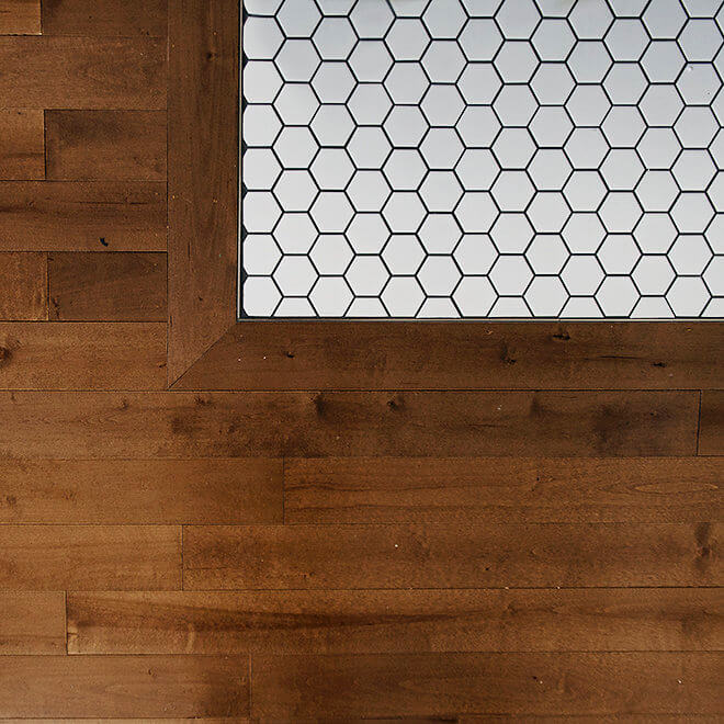 fireplace hearth tile and hardwood detail