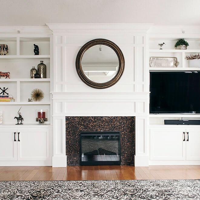 condo remodel living room bookshelf design and fireplace