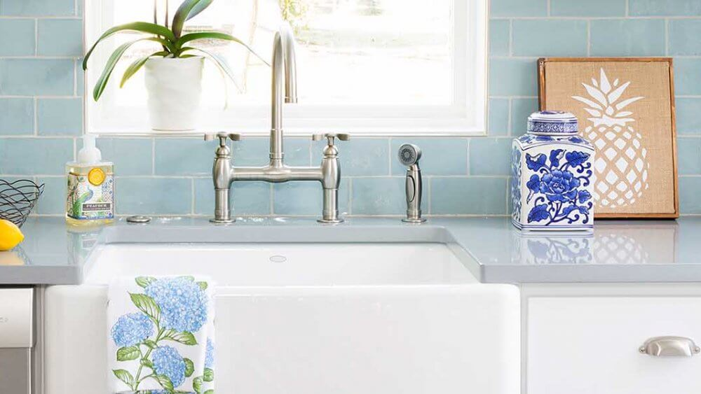 transitional kitchen with blue subway tiles